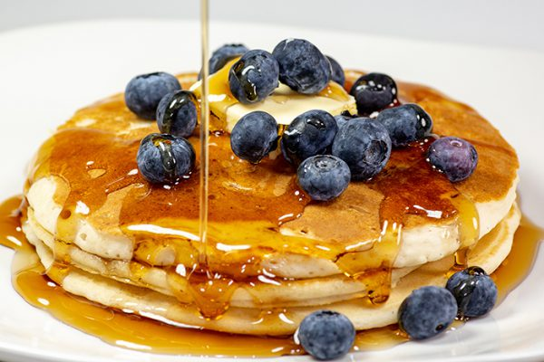 pancakes with blueberries and syrup at Grand Colonial Bed and Breakfast near Cooperstown, NY