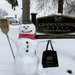 snow man outside grand colonial bed and breakfast